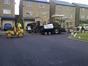 Machine laying tarmac to a private road in Silsden, West Yorkshire
